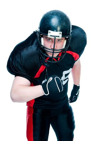 American football player in helmet, studio isolated  Stock Photo