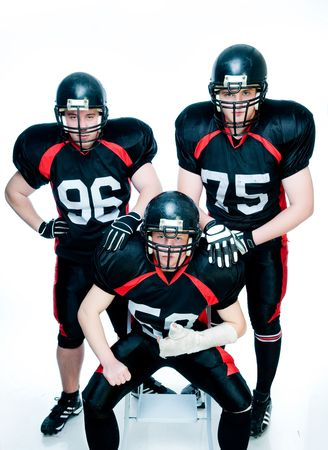 Three American football players