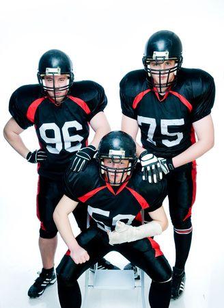 Tre giocatori di calcio americano Archivio Fotografico