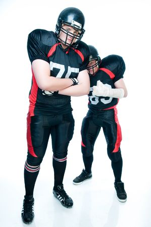 Two American football players over white background   photo