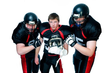 defense: Three American football players