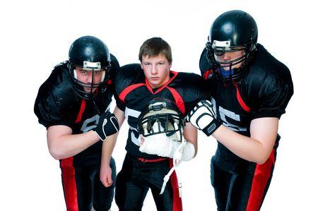 defenses: Three American football players