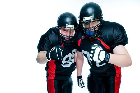 rugby team: Two American football players over white background