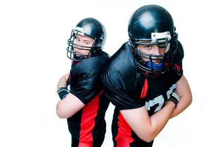 Two American football players, isolated on white background