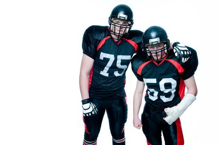 Two American football players, isolated on white  Stock Photo