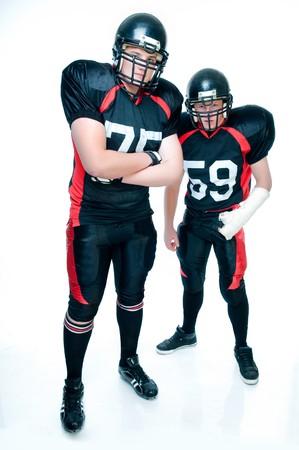白い背景の上の制服のアメリカン フットボール選手