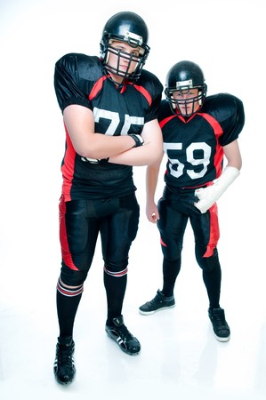 American football players in uniform over white background