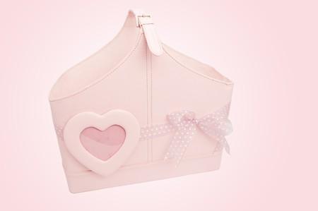 ピンクの背景にピンクのバッグ 写真素材