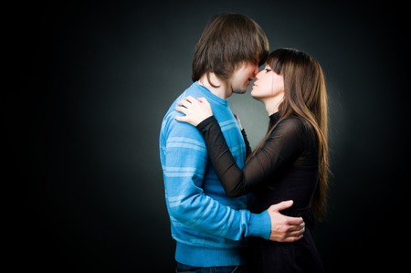 Young lovely couple embracing, studio shot  photo