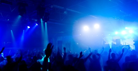 rave: Panoramic photo of people hanging out at the concert, blurred motion  Stock Photo
