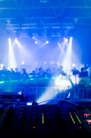 Music mixer desk, blurred crowd on the background