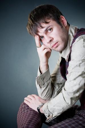 Thoughtful stylish man, studio shot  photo