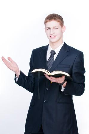 若者が白い背景で隔離の聖書を読む 写真素材