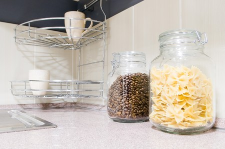 Pasta and coffee beans in glass jars in kitchen interior  photo