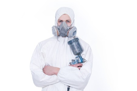 Worker with airbrush gun, isolated on white background   Stock Photo