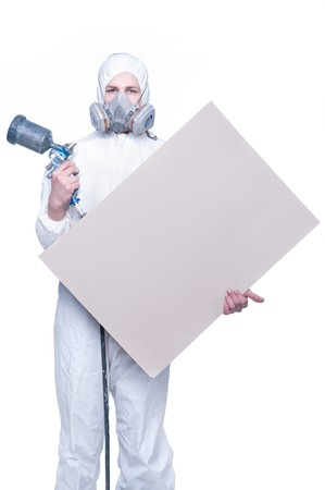 Worker with airbrush gun and blank for your text