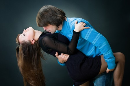 Lovely couple dancing, studio shot   photo
