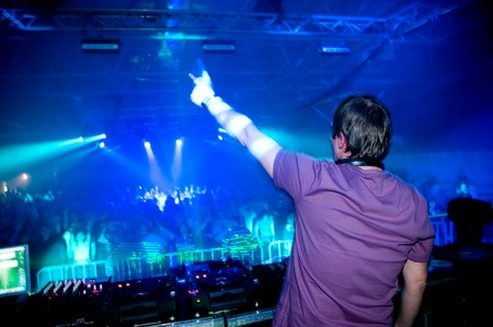 live happy: Dj at the concert, laser show and music