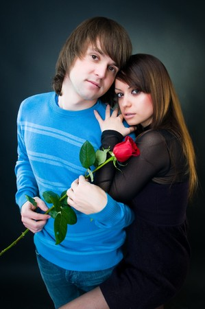 Beautiful couple with rose, studio shot   photo