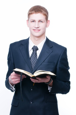 Young man with Bible, isolated on white background