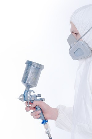 Worker with airbrush gun over white background  photo