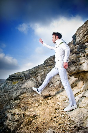 Fashionable man in white suit outdoors