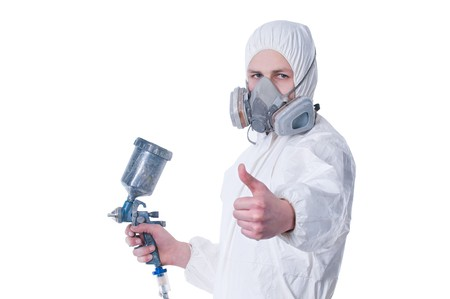 Worker with airbrush gun giving thumbs up, isolated on white background    photo