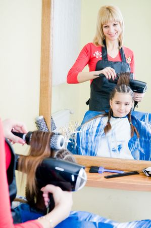 Little girl in hairdresser salon, selective focus   photo