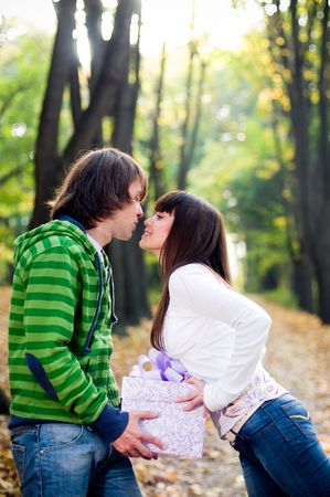 Young couple kissing outside  photo