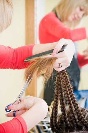 Close-up of haircut in hairdresser salon, selective focus