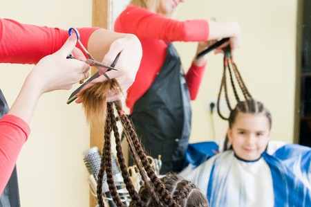 Cute girl in hairdresser salon, selective focus   photo