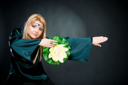 Woman with lotus, studio shot  photo
