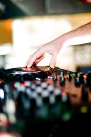 Deejays hand and turntable