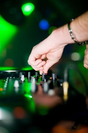 Close-up of deejays hand and turntable