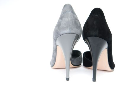 Black and gray female velour shoes, isolated on white background  photo