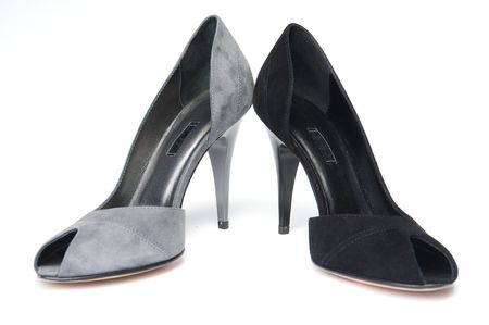 Black and gray female shoes, isolated on white background  photo