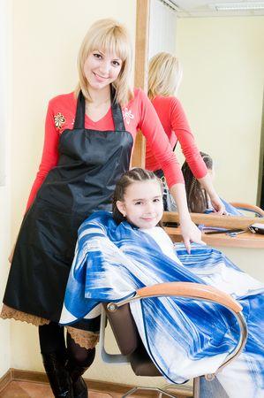 Cute little girl in a barbershop   photo