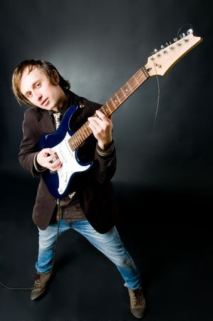 Young man playing electro guitar, high angle view  photo