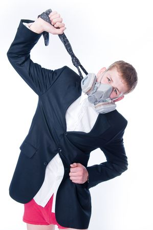 Crazy businessman in respirator hanging himself with his necktie, isolated on white background  photo