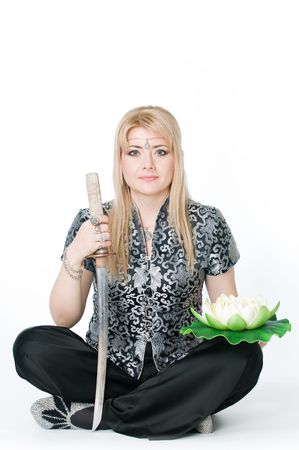 Beautiful woman sitting in lotus pose with katana, isolated on white background Stock Photo - 4755419