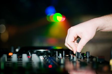 Close-up of deejay's hand and turntable, selective focus