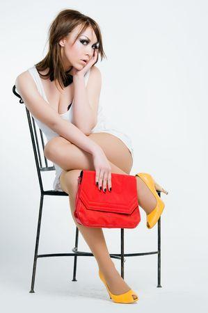 Beautiful pin-up girl with red bag, studio shot  photo