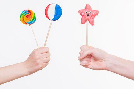 Hands with lollipops, studio shot
