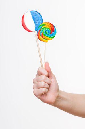 Female hand holding lollipops, studio shot