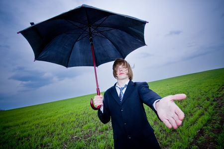 outstretching: Businessman with umbrella outstretching hand � protection concept