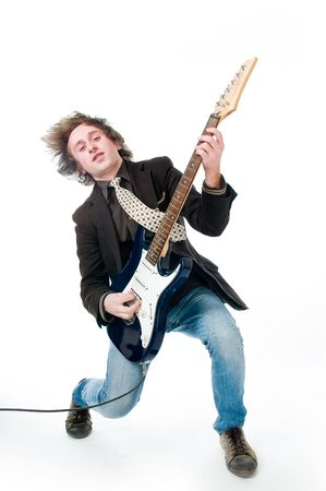 Young man playing electro guitar, isolated on white background  photo