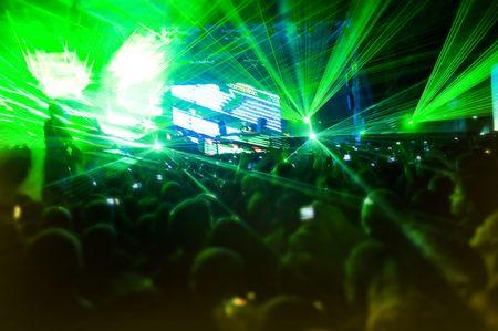 コンサート、ぼやけ動きでレーザー ショー 写真素材
