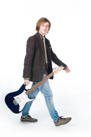 Man walking with electro guitar, isolated on white background  photo