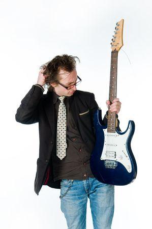 Man with electro guitar, studio shot    photo