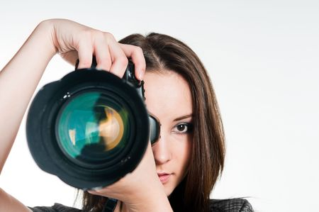 Young girl with professional camera, studio shot  Stockfoto